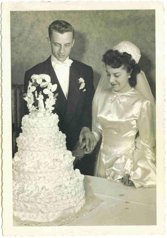 FRANK & LORRAINE CUTTING CAKE AT WEDDING